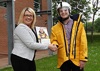 Whale supports RNLI with donation for local crew kit